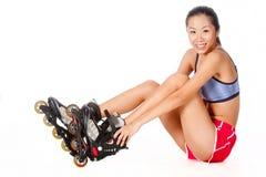 Женщина с Rollerblade стоковые фото