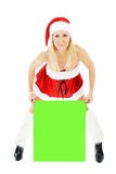женщина удерживания зеленого цвета рождества знамени пустая Стоковое фото RF