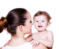 женщина удерживания младенца стоковое изображение rf