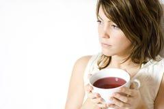 женщина удерживания питья Стоковое Фото