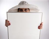 женщина удерживания рамки стоковое фото