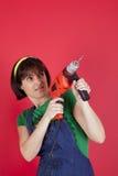женщина удерживания сверла электрическая Стоковая Фотография