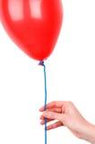 женщина удерживания s руки воздушного шара стоковое изображение