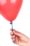 женщина удерживания s руки воздушного шара стоковые фото