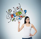 Женщина указывает вне палец на красочном эскизе плана для деятельностей при развития биснеса Свет - задняя часть сини Стоковое Изображение RF