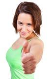 Женщина усмехается и показывает ее Стоковые Фото