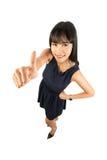 Женщина успеха давая большие пальцы руки поднимает знак Стоковое фото RF