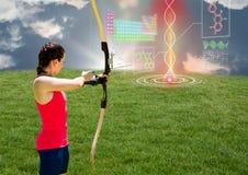 Женщина лучника направляя футуристическую цепь дна в поле Стоковые Изображения RF