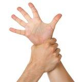 Женщина удерживания человека запястьем руки Стоковая Фотография