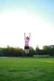 Женщина фитнеса азиатская китайская скачет Стоковое Изображение