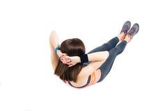 Женщина фитнеса делая подбрюшные тренировки стоковое фото rf