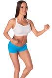 Женщина фитнеса стоя против изолированной белой предпосылки Стоковое Фото