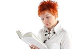 женщина чтения книги Стоковые Изображения RF