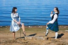 женщина шпаги человека costume шотландская Стоковое фото RF