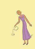 Женщина льет кофе в чашку стоковое фото rf