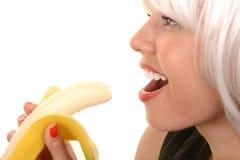 Женщина любит ее банан стоковые фотографии rf