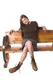 женщина юбки усаживания стенда серьезная стоковое изображение rf