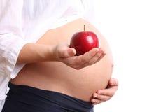 женщина яблока супоросая красная Стоковые Фото
