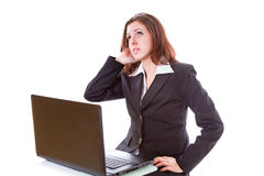 Женщина дела работая на компьтер-книжке Стоковое фото RF