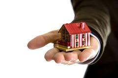 женщина дома удерживания руки малая Стоковая Фотография