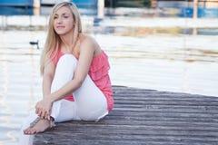 Женщина daydreaming Стоковые Фотографии RF