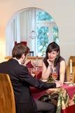 Женщина Flirting в ресторане Стоковое фото RF