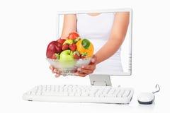 женщина fruits удерживание руки стоковое фото rf