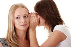 женщина gossiping Стоковые Фотографии RF