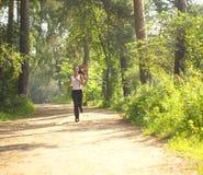 женщина jogger сельской местности Стоковое Изображение RF