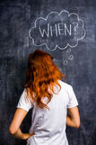 Женщина Redhead спрашивая когда Стоковая Фотография RF
