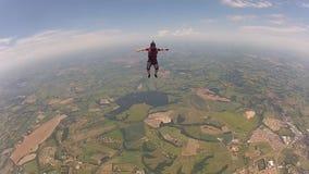 Женщина Skydiving сидит муха видеоматериал