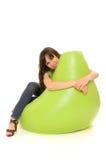 женщина smiley embrace стула Стоковое фото RF