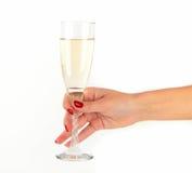 Женщины вручают держать стекло шампанского Стоковые Изображения RF