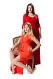 2 женщины в длинном красном платье Стоковая Фотография