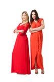 2 женщины в длинном красном платье Стоковые Фото