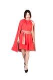 Женщины в красном платье на белизне Стоковое Изображение