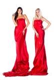 2 женщины в красном платье Стоковая Фотография