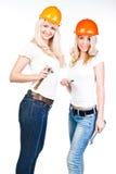 2 женщины в шлемах конструкции Стоковое фото RF