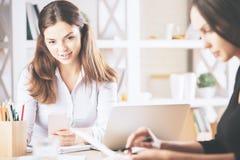 Женщины делая обработку документов Стоковые Изображения RF