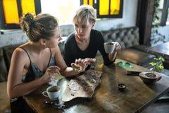 Женщины есть в кафе Стоковое Изображение
