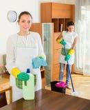 2 женщины делают очищать совместно Стоковая Фотография