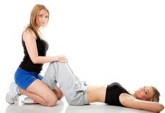 2 женщины делая изолированную тренировку фитнеса Стоковые Фотографии RF