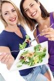 Женщины здоровья сознательные наслаждаясь салатом Стоковое фото RF