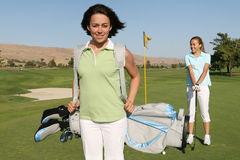 женщины игроков в гольф Стоковые Фото