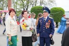 2 женщины и один человек в медалях Стоковая Фотография