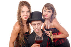 2 женщины и человек в вампире маскировки Стоковая Фотография RF