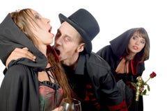2 женщины и человек в вампире маскировки Стоковые Изображения RF