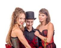 2 женщины и человек в вампире маскировки Стоковое Изображение RF