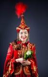 Женщины казаха с цветками Стоковые Фото