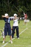 женщины команды archery s действия Стоковые Изображения